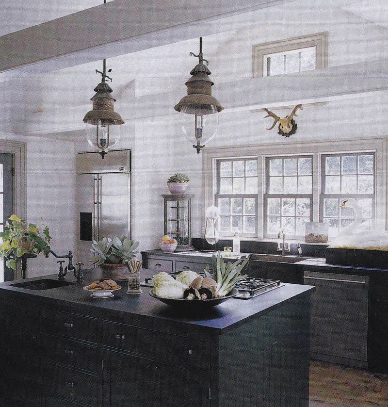 Beautiful dark forest green cabinets (unfortunately I dont' know who